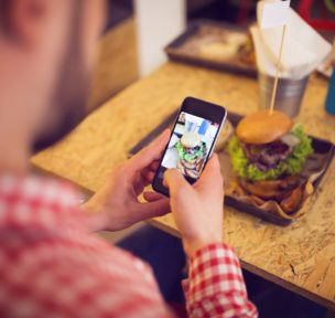 Man uses a digital restaurant marketing strategy